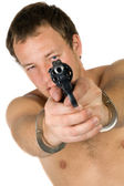The young man with a pistol. Isolated — Stock Photo