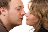 Portrait of young kissing couple. Isolat — Stock Photo