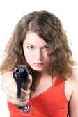 Young woman with a pistol. Isolated on w — ストック写真
