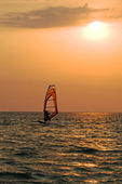 Silhouette of a windsurfer on a gulf on — Stock Photo