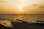 Silhouette of a two windsurfer on a gulf — Stock Photo