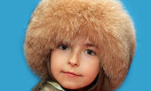The girl in a fur cap — Stock Photo
