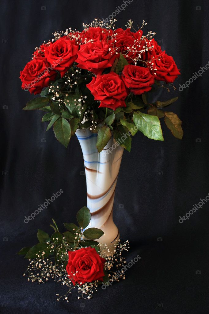 Bouquet of red roses in a decorative vase on a black background  Stock Photo #1131527