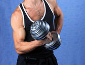 Man with dumb-bells. — Stock Photo
