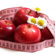 Foto Stock: Apples, camomiles and centimetre.