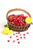Grains of a pomegranate and flowers. — Stock Photo