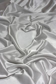 Grey silk and heart. — Stock Photo