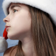 Girl is in the Christmas cap. — Stock Photo