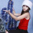 Girl in a cap near the Christmas symbols — Stock Photo