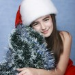 Girl in a cap with the Christmas symbols - Photo