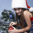 Girl in a cap with the Christmas symbols — Stock Photo