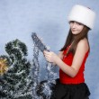 Girl in a cap with the Christmas symbols - Stock Photo