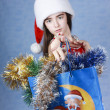 Girl with purchases in Christmas cap — Stock Photo #1233207