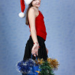 Girl with purchases in the Christmas cap - Stock Photo