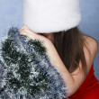 Sad girl with the Christmas decorations - Stock Photo