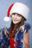 Girl in a cap with the Christmas decorat — Stock Photo