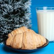 Milk, croissants and the tree of Christm — Stock Photo