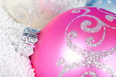 Tender Christmas bauble on to snow. — Stock Photo