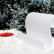 Stock Photo: Burning candle and scroll on snow.