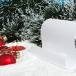Stock Photo: Candle, scroll and trinket heart on snow