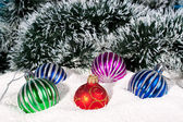 Beautiful,bright Christmas balls in snow — Stock Photo