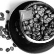 Coffee beans in a coffee cup. — Stock Photo #1967592
