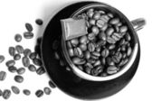 Coffee beans in a coffee cup. — Stock Photo