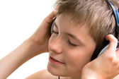 The boy listens to music — Stock Photo