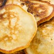 Yellow pankakes background — Stock Photo
