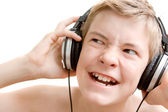 The crazy boy listens to music — Stock Photo