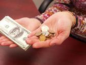 Female hands weigh coins and denominatio — Stock Photo