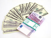 Dollars and euro on a white background — Stock Photo