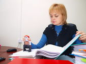 The bookkeeper works with documents — Stock Photo