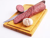 The cut sausage on a white background — Stock Photo
