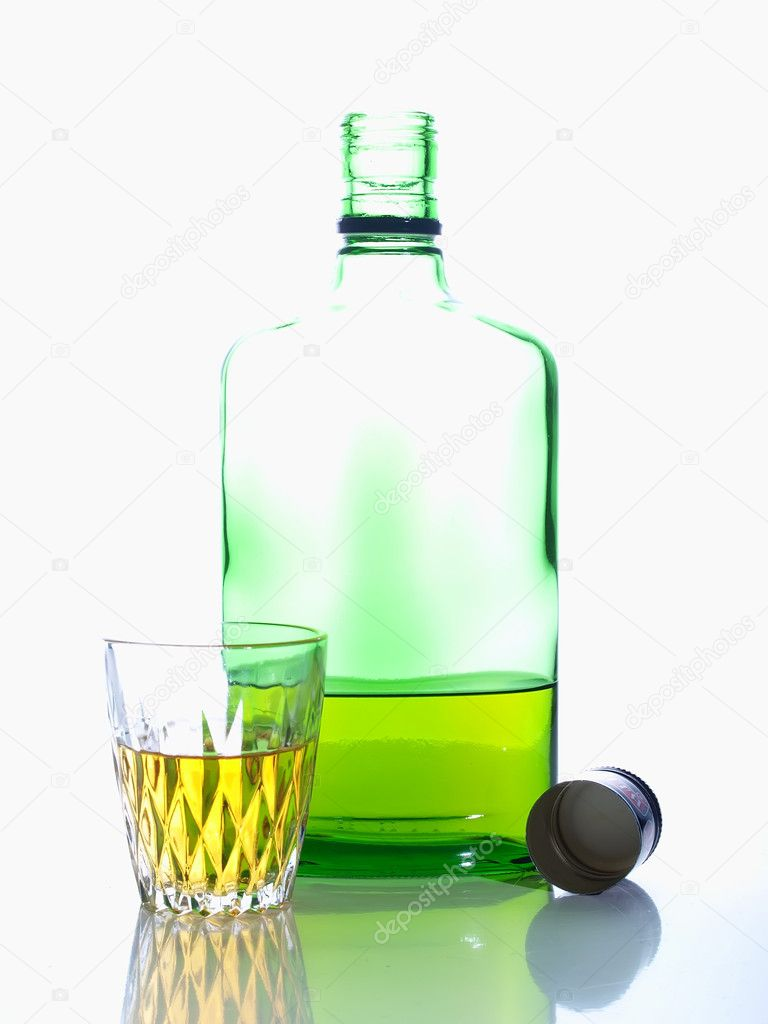Green bottle and pile with alcohol on a white background. — Stock Photo #2250168