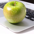 Stock Photo: Laptop and green apple