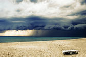 Stormy weather with rain on the beach — Stock Photo