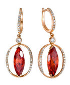 Earrings with red zircon isolated — Stock Photo