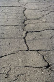 Old asphalt road with fissure — Stock Photo
