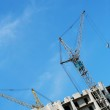 Building crane and building house — Stock Photo