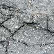 Old asphalt road surface texture - Stock Photo
