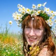Royalty-Free Stock Photo: Beautiful girl in the wreath of daisies