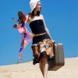 Beautiful girl is walking on a sand — Stock Photo #1390747