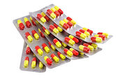 Red and yellow paks of pills isolated — Stockfoto