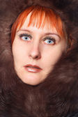 Girl with fur coat. — Stock Photo