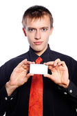 Young businessman holds an empty business card — Stock Photo