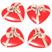 Red hearts with ribbon — Stock Photo