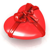 Red heart with ribbon — Stock Photo