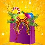 Christmas gift bag, ball, holly, cane — Stock Photo