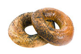Bagels with poppy seeds on white background — Stock Photo